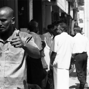 Man thumbing up in the busy street