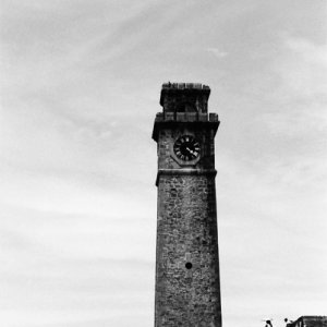 Darkish clock tower rising in Galle