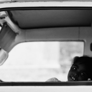 Girl looking at me from inside of car