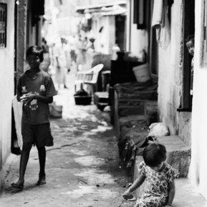 Kids playing in lane in each way