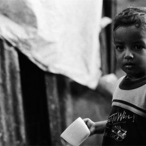 Boy gazing with mug in his hand