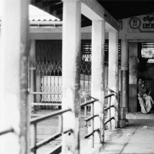 Man sitting in quiet market