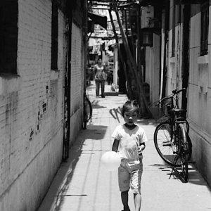 Sullen girl walking with balloon