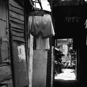 Laundries hung in dim lane