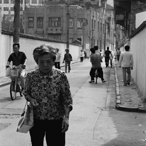 Downcast woman walking street