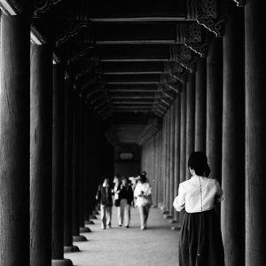 Woman with a Chima jeogori walking cloister