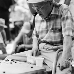 Old man playing Go in park