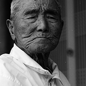 Frowned face of an old man
