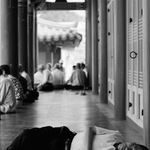 Local people relaxing in hall