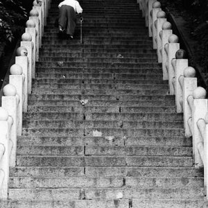 Older woman climbing steep stairway