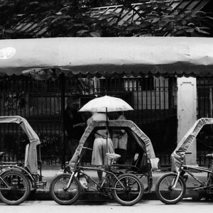 Tricycles parked in taxi-stand-like place