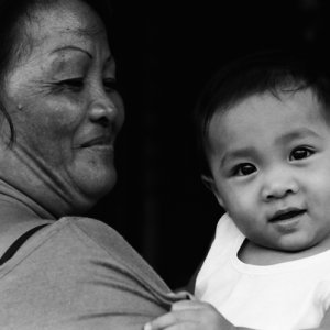 Baby smiling in arms of grandmother