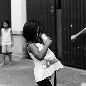 Girl drinking by roadside