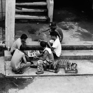 Some men playing chess in market