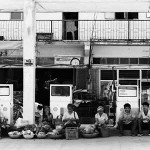 Many hawkers resting under roof in gas station