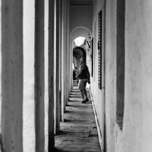Man walking narrow passage way