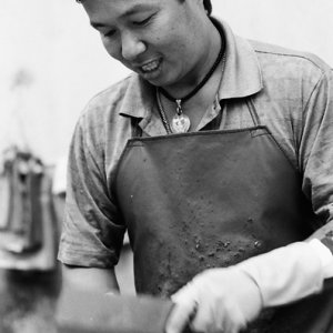 Man cutting chickens