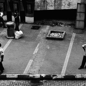 Two men stopping on edge of sidewalk
