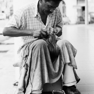 Shoemaker working by roadside
