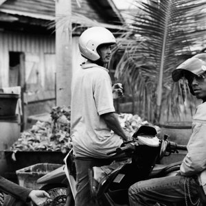 Three men wearing helmet