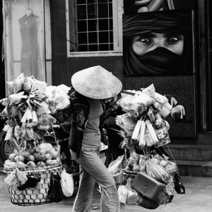 Woman carrying many goods with yoke