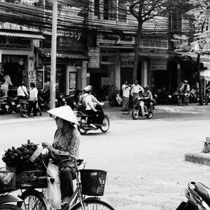 Peddler parking bicycle by roadside