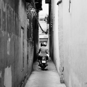 Motorbike running lane flanked by walls