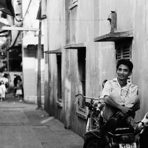 Man holding legs on motorbike