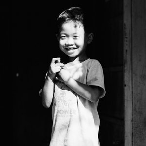 Boy smiling in sunlight