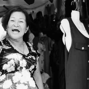 Cheerful woman in boutique