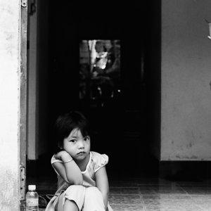 Little girl sitting at entrance