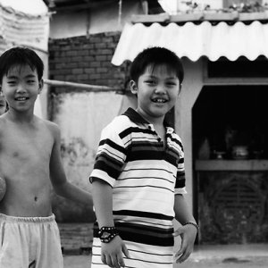 Boys playing with ball in lane