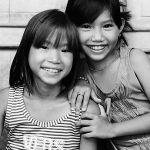 Two girls smiling together