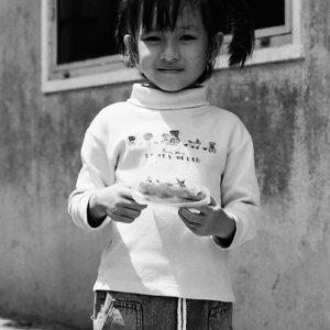 Girl holding snacks importantly