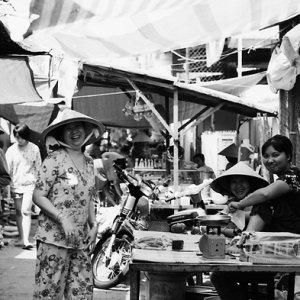 People smiling in street market