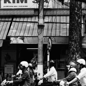 Many motorbikes running wide street