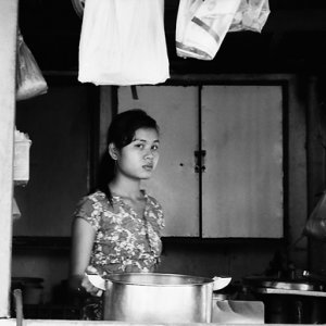 Young woman working in eating place
