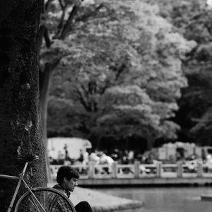 Man sat near pond