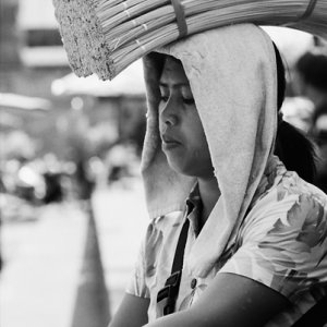 Woman working while putting something on head
