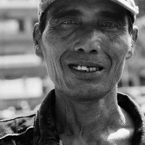 Man wearing worn cap