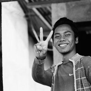 Young man replying with peace sign