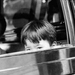 Boy peeping tentatively