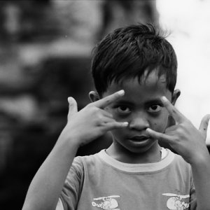 Boy looking from between fingers