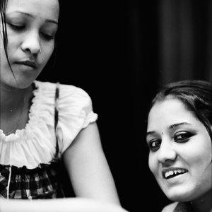 Women chatting by wayside