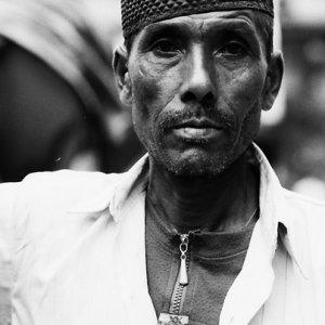 Rickshaw man with hollow cheek