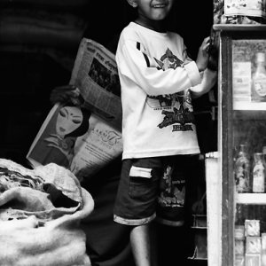 Curious boy in storefront