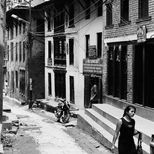 Woman walking old street