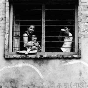 Mother and kids relaxing by window