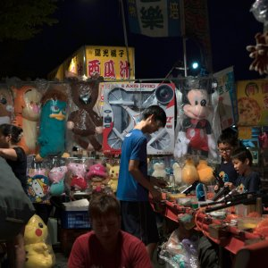 Shooting game in night market
