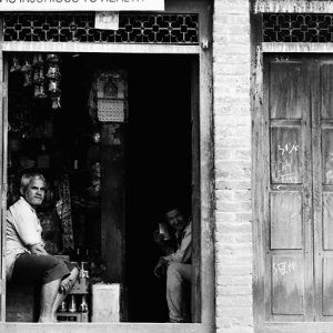 Men chatting in storefront